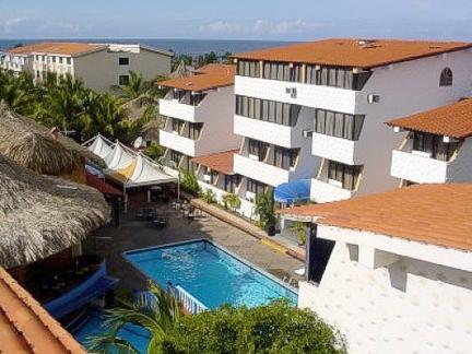 Hotel puerta del sol playa el agua oferta margarita for Hoteles cerca puerta del sol